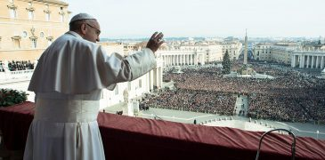 """Pope Francis greets the crowd after delivering his Christmas message and blessing """"urbi et orbi"""" (to the city and the world) from the central balcony of St. Peter's Basilica at the Vatican Dec. 25. (CNS photo/L'Osservatore Romano) See POPE-CHRISTMAS Dec. 25, 2016."""